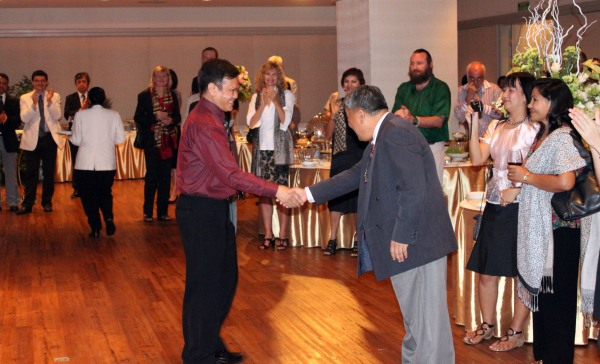 Dr. Malla and Dr. Thaung shake hands