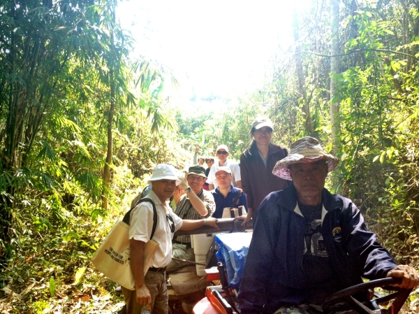 The visitors enjoyed touring the Huai Hin Dam community forest on a tractor-pulled wagon.
