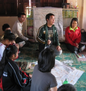 Compiling the information collected from the villagers in plenum from the different groups.